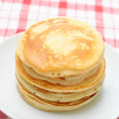 Stock Photo: Pile of fresh hot pancakes