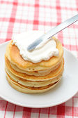 Pancakes with whipped cream — Stock Photo