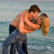 Couple Embrace In The Surf - Stock Photo