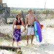 Couple Headed To Beach - Stock Photo