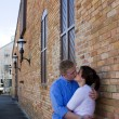 Couple Kissing By Brick Building — Stock Photo