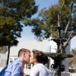 Couple Kissing By Water Fountain — Stock Photo