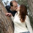Couple Kissing In Tree — Stock Photo