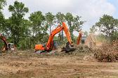 Retroescavadeiras, limpando a terra — Foto Stock