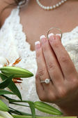 Bride Holding Grooms Ring — Stock Photo