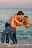 Couple Embrace In The Surf — Stock Photo