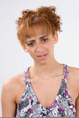A young woman showing the emotion of disappointment and defeat. — Stock Photo