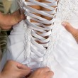 Stock Photo: Lacing Wedding Gown