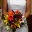 Bride Holding Wedding Bouquet — Stock Photo #1414640