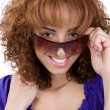 Woman Peeking Over Sunglasses — Stock Photo