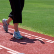 Woman Running Track - Stock Photo