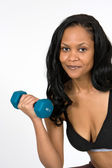 African-American Woman Lifting Dumbbell — Stock Photo