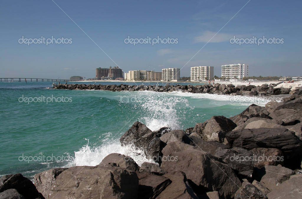 Seaspray blows over the jetty rocks at Destin, Florida. — Stock Photo #1413084