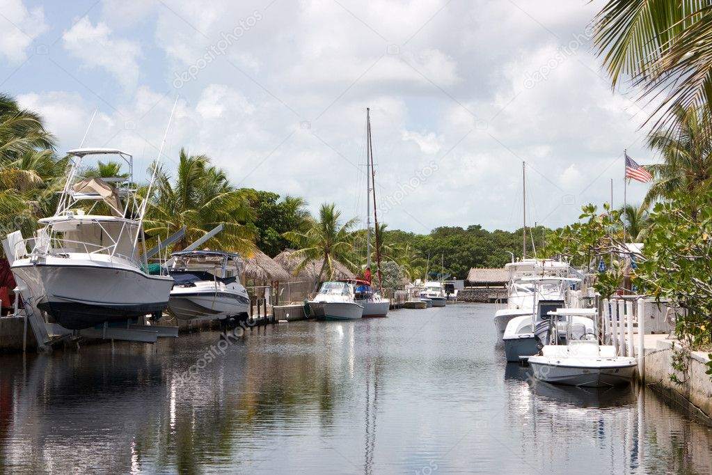 Pleasure boats line the canal in Key Largo, Florida.  Stock Photo #1413092