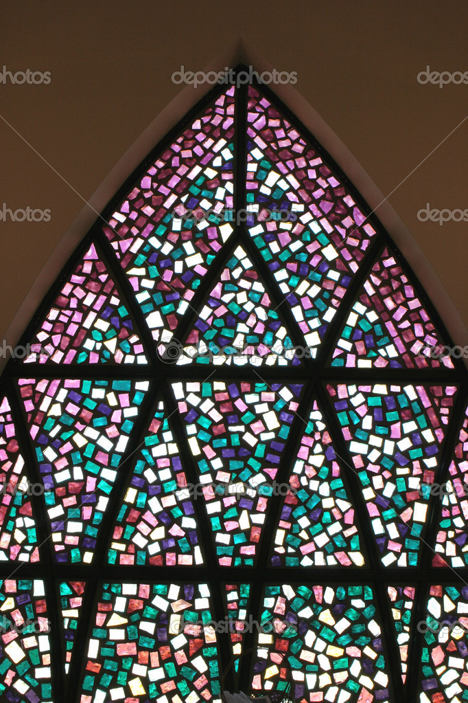 Stained glass window is formed in the shape of an arch. — Stock Photo #1414351