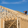 Carpenter Building Roof - Stock Photo