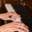 Old Hands Playing Piano — Stock Photo