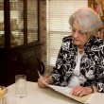 Senior Adult Woman Reading Magazine — Stock Photo