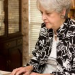 Senior Adult Working At Home - Stock Photo