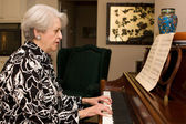 Senior Woman Playing Piano — Stock Photo