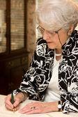 Senior Woman Writing Letter — Stock Photo