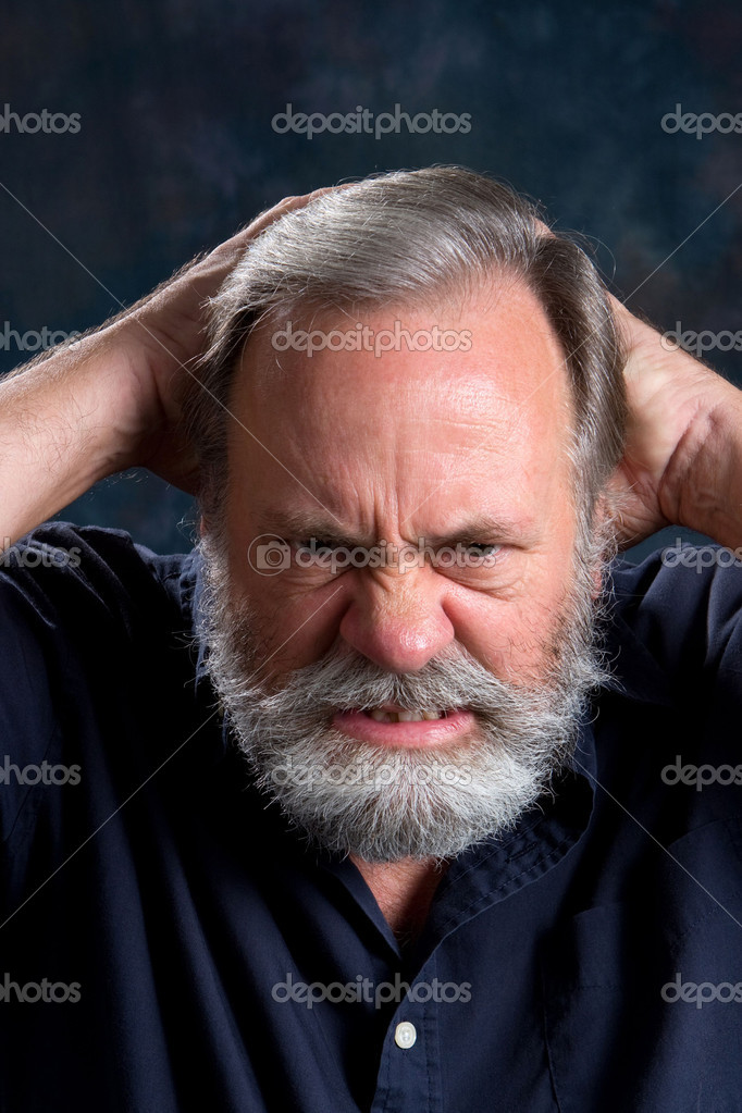 Man holds the back of his head in frustration. — Stock Photo #1439749