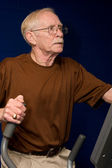 Senior Man On Elliptical Machine — Stock Photo