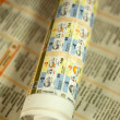 Rolled newspaper — Stock Photo