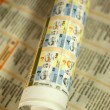 Stock Photo: Rolled newspaper