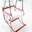 Seat of merry-go-round with snow — Stock Photo