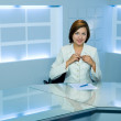 Television anchorwoman at TV studio — Stock Photo #1397927