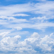 Royalty-Free Stock Photo: Fluffy clouds in blue sky