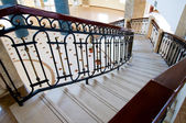 Winding staircase with forged rail — Stock Photo