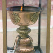 Stock Photo: Buddhist altar lamp