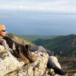 Man relaxing at mountain top — Stock Photo