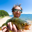 Stock Photo: Fisherman with a catch