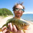 Fisherman with a catch — Stock Photo