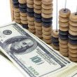 Dollars & abacus — Stock Photo