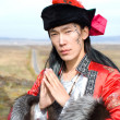Man in Mongolian costume — Stock Photo