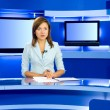 Television anchorwoman at TV studio — Stock Photo #1407161