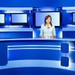 Television anchorwoman at TV studio — Stock Photo #1407219