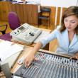 Audio operator at audio control console - Stock Photo