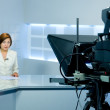 Television anchorwoman live broadcasting — Stock Photo