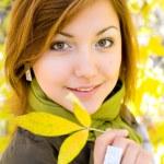 Beautiful girl with autumn leaf — Stock Photo