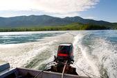 Water waves behind motorboat — Stock Photo