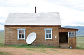 Country house with satellite dish — Stock Photo