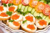 Bread with red caviar — Stock Photo