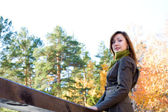 Beautiful girlin in autumn forest — Stock Photo