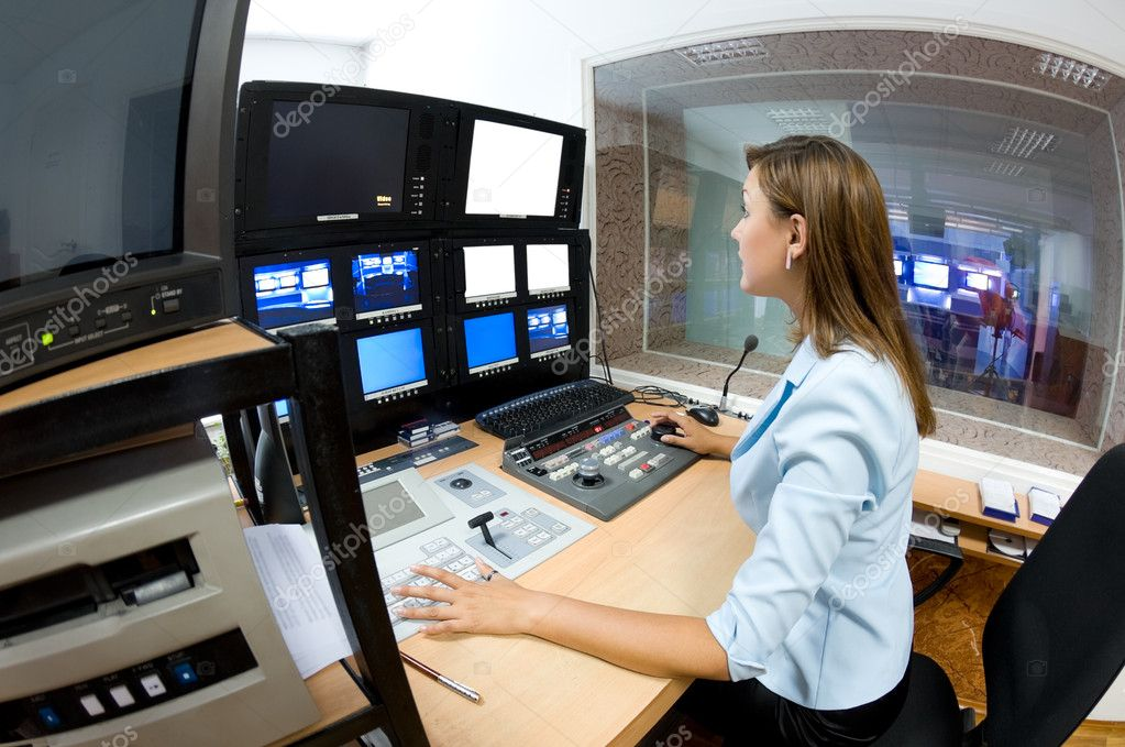 Female TV director at editor in studio — Stock Photo #1407281