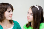 Two beautiful girls look at each other — Stock Photo